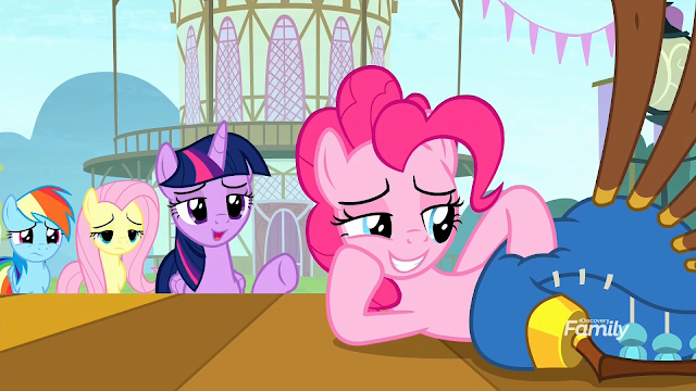 Pinkie's friends look on, disturbed, as Twilight talks to her as she is laying on her side, stroking the yovidaphone.