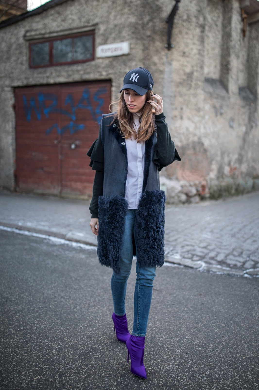 long shearling vest levis jeans purple sock boots outfit