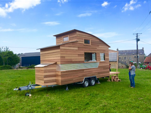 curved French tiny house