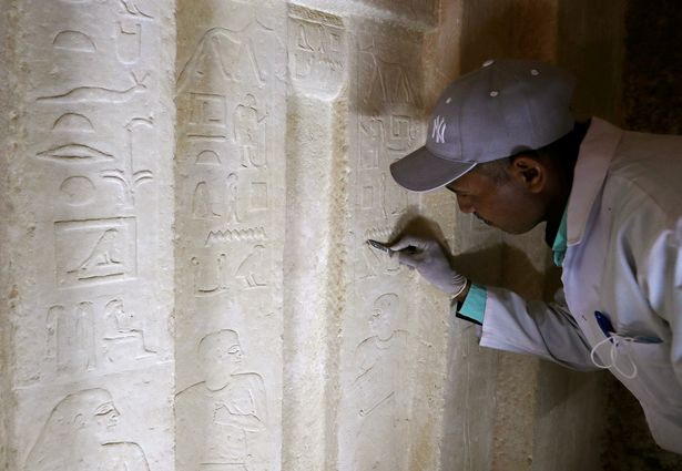 An Egyptian archaeologist works at the newly discovered burial site dating back to circa 2500 B.C