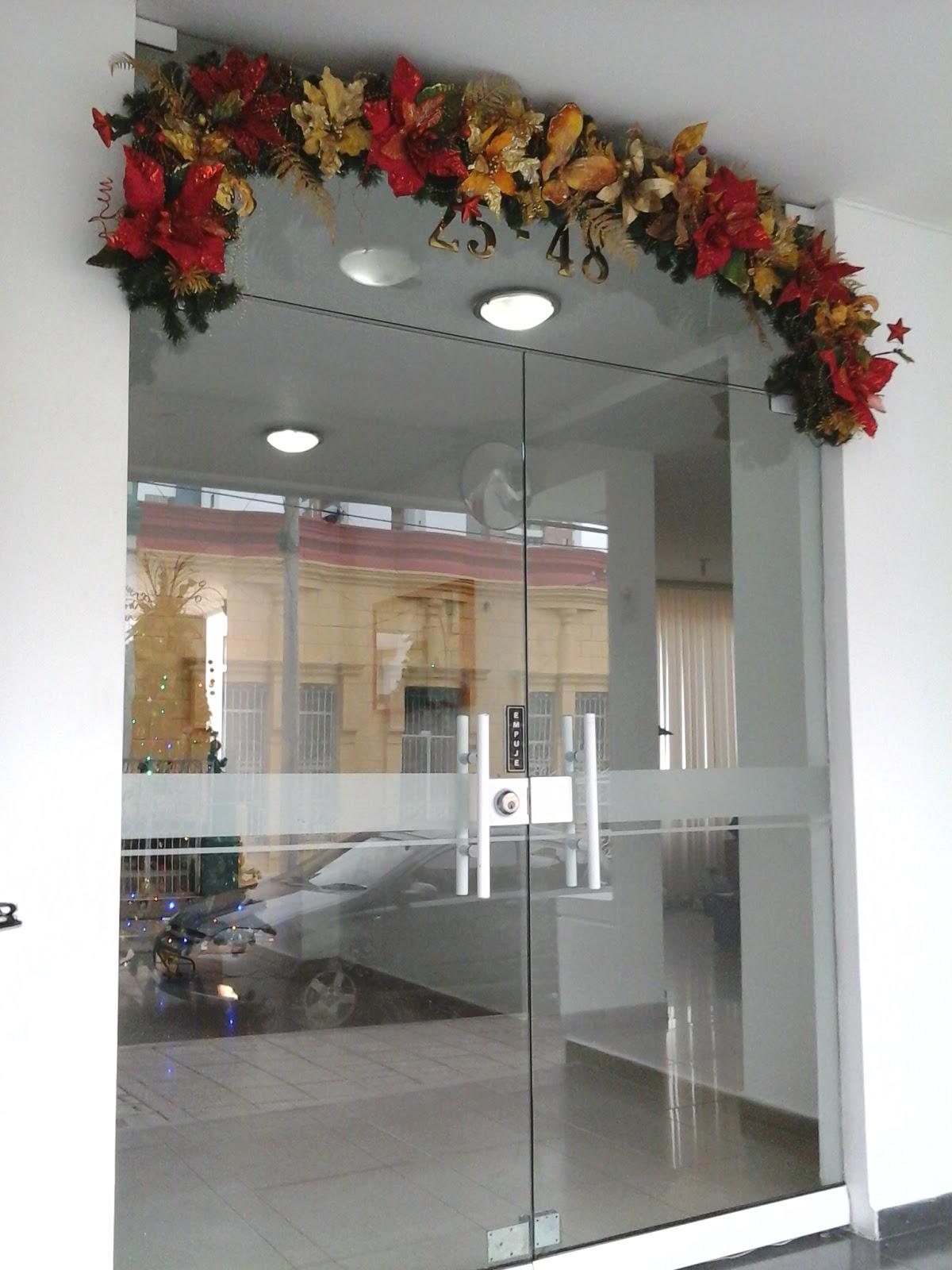 Guirnaldas para fachadas decoraciones navide as for Guirnaldas para puertas navidenas
