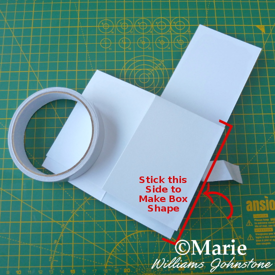 Sticking the handmade pop up box card shape together assembly