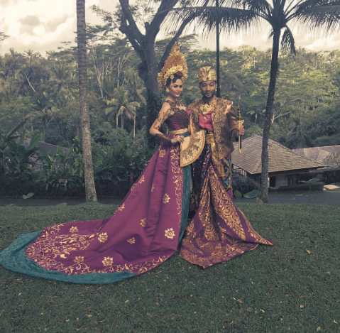 Chrissy Teigen & Her Husband John Dress Up In Traditional Cultural Outfits As They Round Up Indonesian Vacation