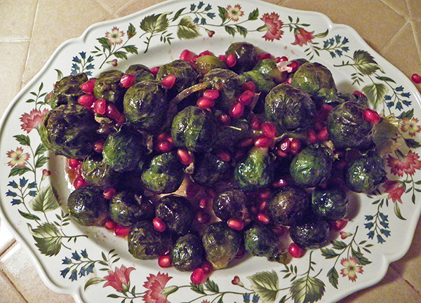 Brussels sprouts on Platter sprinkled with Pomegranate seeds