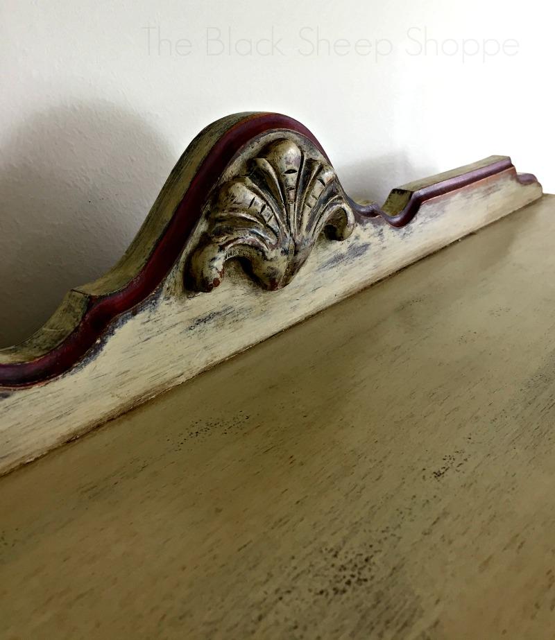 Decorative apron piece on top of dresser