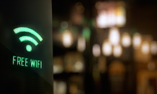 photo of Free Wifi lighted sign with blurred background