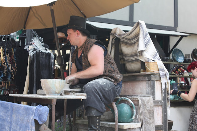 Potter spinning pottery at the Bristol Renaissance Faire