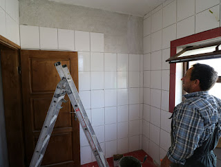 Bekir admiring the last wall to be tiled