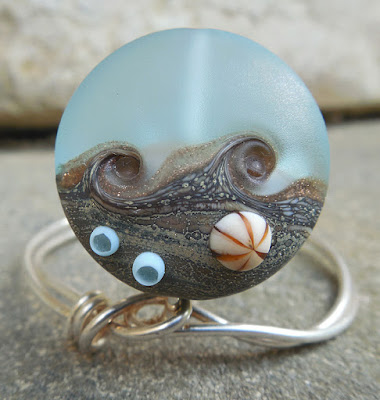https://www.etsy.com/listing/384811572/beachcomber-10-ssl-lampwork-focal-bead?ref=shop_home_active_5