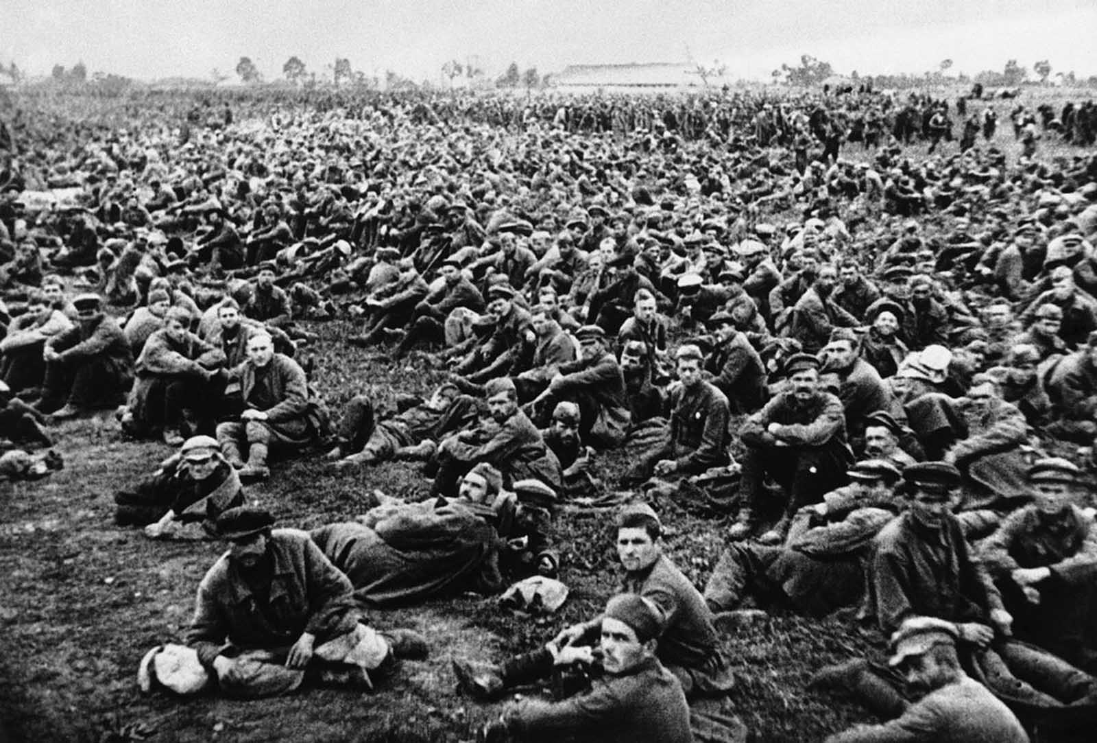 Evidence of the fierce fighting on the Moscow sector of the front is provided in this photo showing what the Germans claim to be some of the 650,000 Russian prisoners which they captured at Bryansk and Vyasma. They are here seen waiting to be transported to a prisoner of war camp somewhere in Russia, on November 2, 1941.