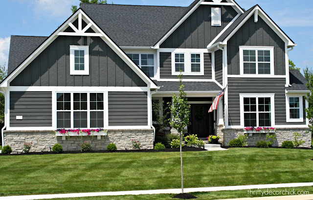 Dark gray Craftsman style home with gray paint white trim