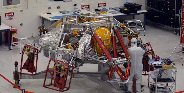 A technician works on the descent stage for NASA's Mars 2020 mission inside JPL's Spacecraft Assembly Facility. Mars 2020 is slated to carry NASA's next Mars rover to the Red Planet in July of 2020. Image credit: NASA/JPL-Caltech