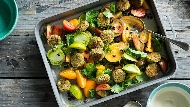 Teamed with a fresh herb and tomato salad and tasty tahini dressing Baked falafel with tomato herb salad & tahini sauce recipe
