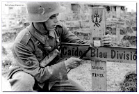 "Franco did not officially involve Spain on the Axis side, but Spanish volunteers did fight in the Wehrmacht. It was called the ""Blue Division""(the 250th infantry division). Here a soldier is seen by the grave of a comrade"