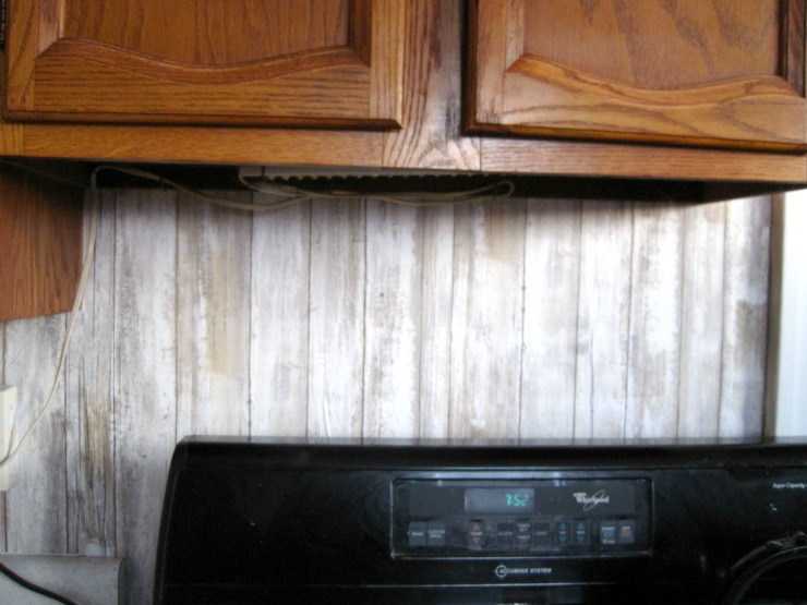 kitchen backsplash options a wall paper back splash that has a rustic look