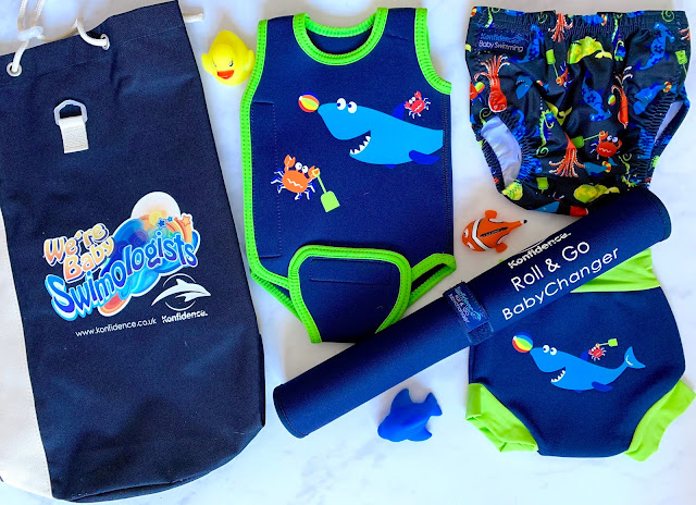 Konfidence Baby Swimming kit including a babywarma with shark design, nappies and pool side changing mat