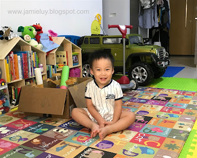 Toddler happy with Ikea dollhouse and jeep