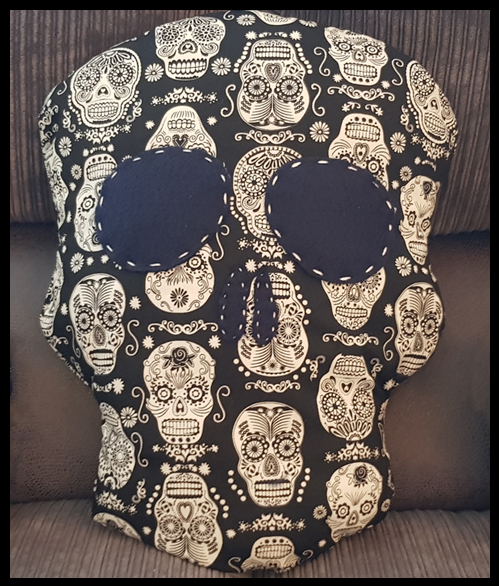 Skull cushion made with Day of the Dead glow in the dark material