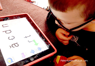 Jude practicing phonics sounds with the McGuffey App.