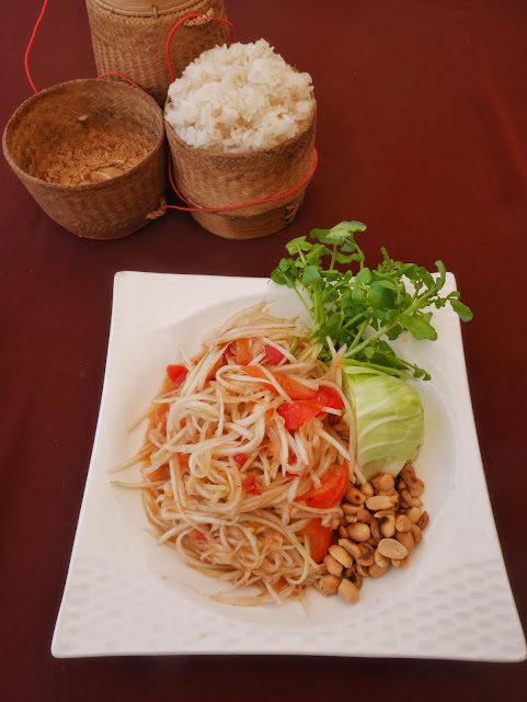 sticky rice, papaya salad, peanuts, laotian spicy dish