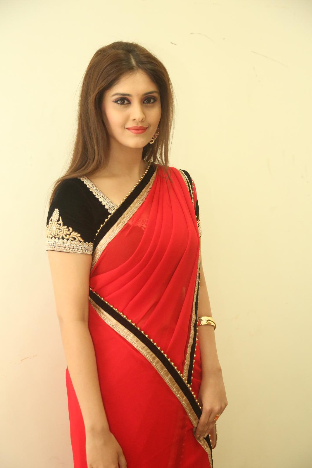Actress Surabhi Latest Stills In Red Saree