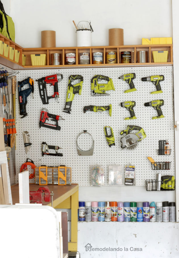 Ryobi tools on pegboard - spray paint cans and yellow bench