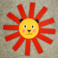 A sample of the lion I designed for the Team Animal Mural. The girls wrote two facts about lions on orange strips and then used them to create the lion's mane at the following troop meeting.