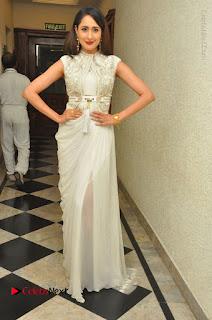 Actress Pragya Jaiswal Stills in Beautiful White Dress at turodu Audio Launch  0040.JPG