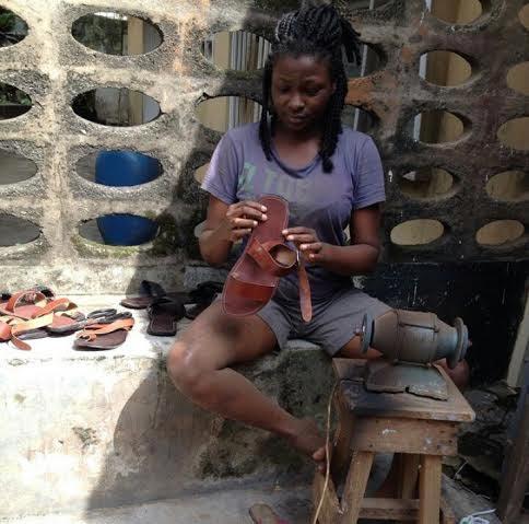 Meet pretty lady Michelle Ekure, a UNIBEN graduate who makes a killing as a shoe cobbler
