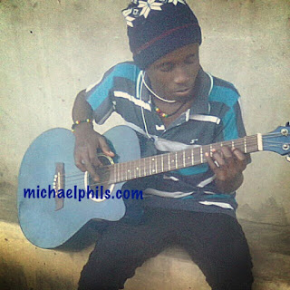 guitarist playing african queen by tu face on the guitar