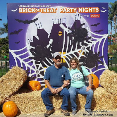 Jimmy and Cindy sitting on hay bales at a Legoland Halloween display.
