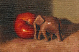 Oil painting of a small carved wooden elephant beside a red tomato.