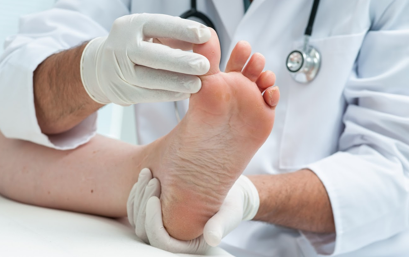 A Doctor Checking Feet Of Patient