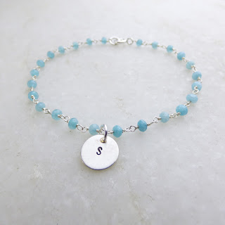 Blue stone charm bracelet with personalised disk