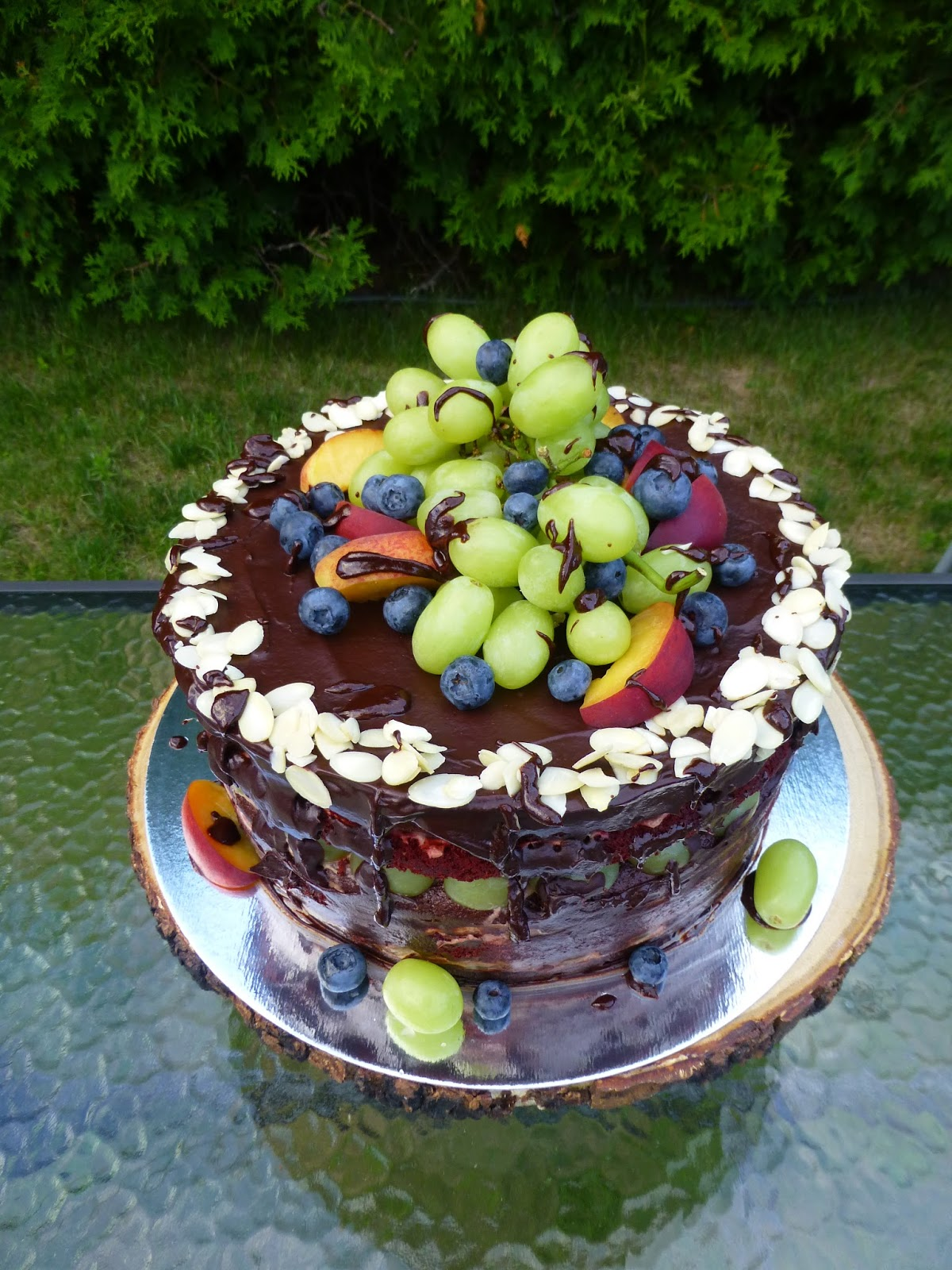 This Time I Used Grapes Peaches And Blueberries The Decoration Is Chocolate Ganache Finely Ground Almonds Fresh Fruits Happy Birthday
