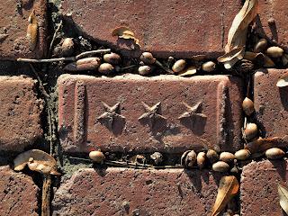 Sidewalk brick with three stars