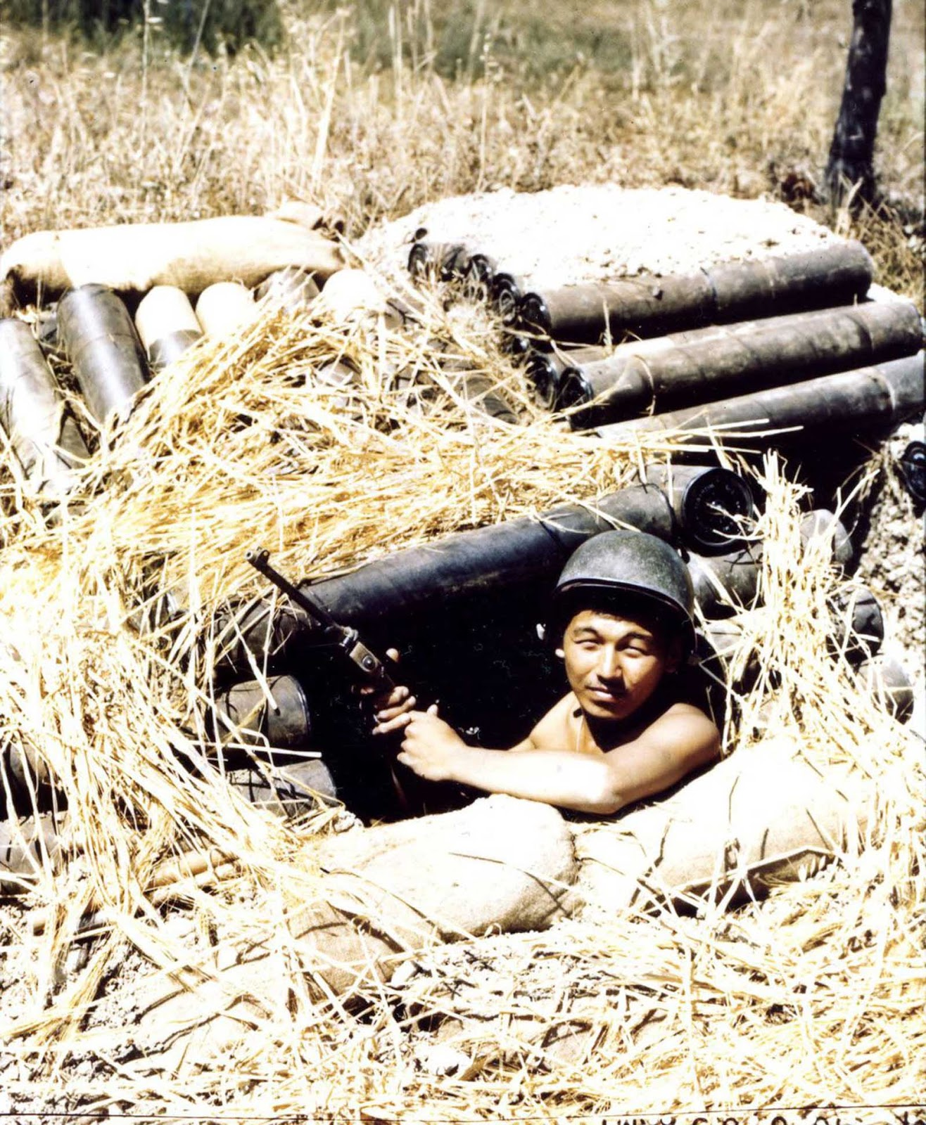 Private Tsuneo Shiroma, of the 522nd Field Artillery Battery B, in a foxhole during the Allied invasion of Italy. 1943.