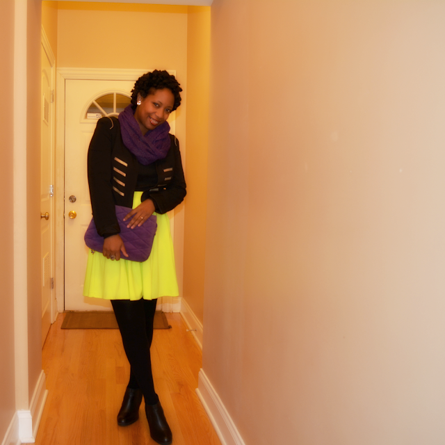 neon green skater skirt worn with black and purple accessories