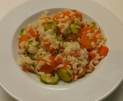 Rice with carrots, zucchini and tomatoes