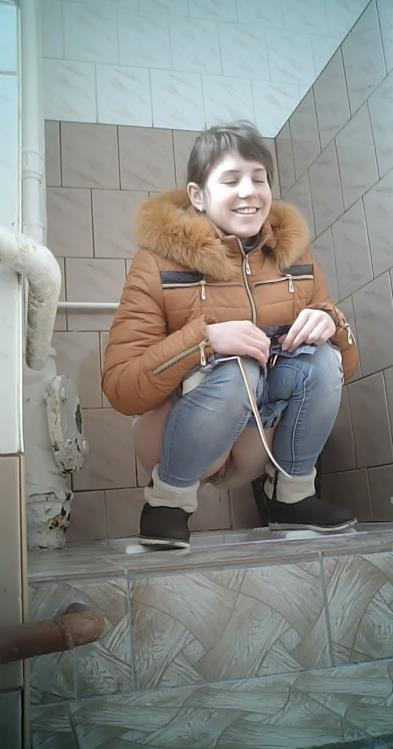 Female peeing in toilet