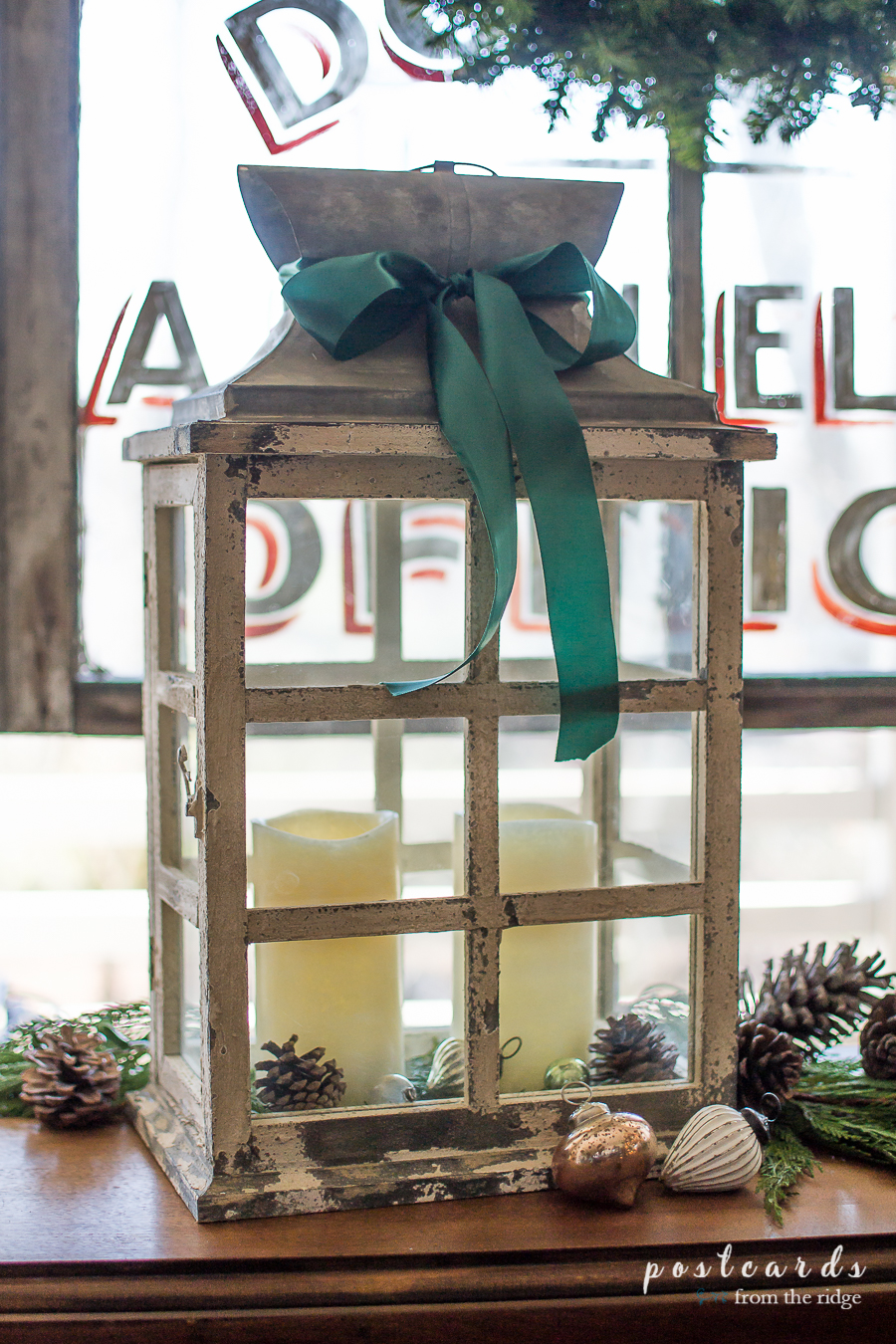 vintage style wooden candle lantern with flameless candles and green ribbon