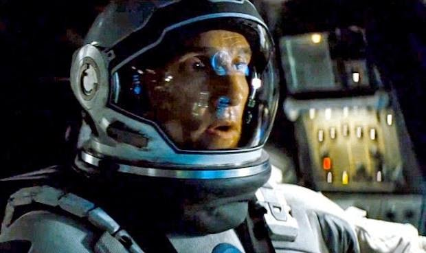 Matthew McConaughey as Cooper in Interstellar, wearing a space suit, Directed by Christopher Nolan