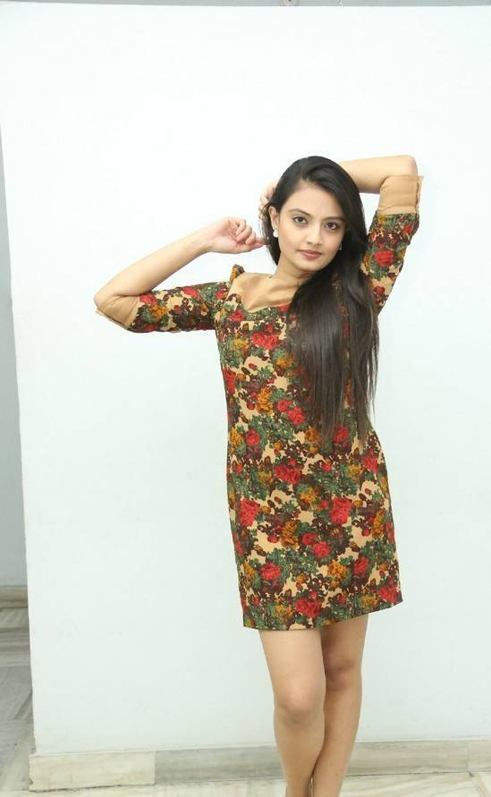 Nikitha Narayan Legs Thighs Show Stills In Green Mini Skirt At Album Launch