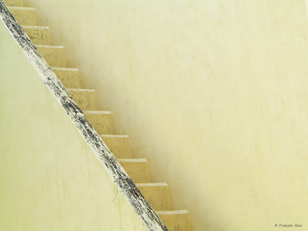 A Minimalist Photo of A yellow Staircase at Jantar Mantar Jaipur