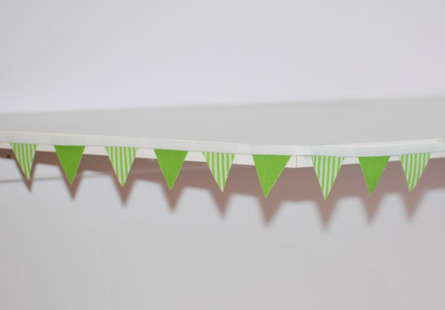 bunting attached to shelf