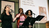 Katelin, Molly, and Carol sing during worship