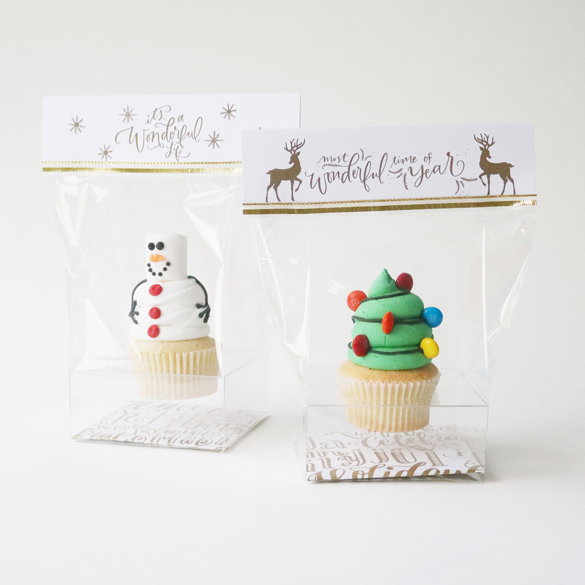 Snowman and Christmas tree cupcakes packaged for gift giving - free download for the gift topper printables | Creative Bag and Bake Sale Toronto