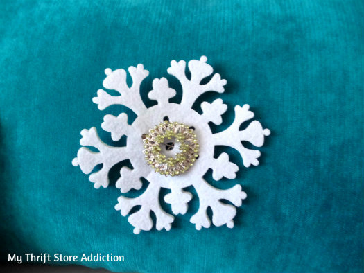 Recreate Your Pillows: A Holiday Fashion Show mythriftstoreaddiction.blogspot.com Use a vintage brooch to pin on a felt snowflake for a new look