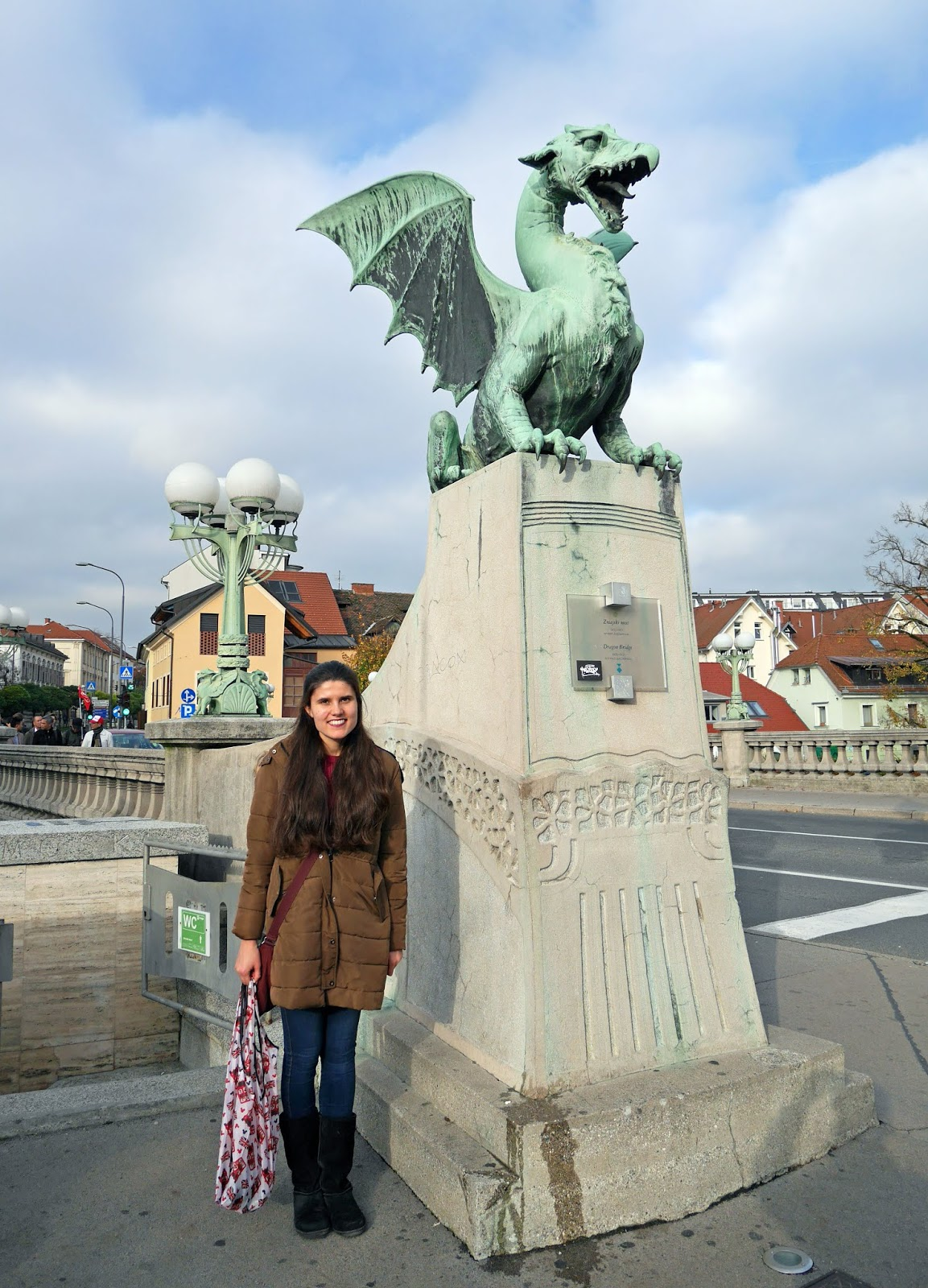 Kat Last standing by the Dragon Bridge in Ljubljana, Slovenia