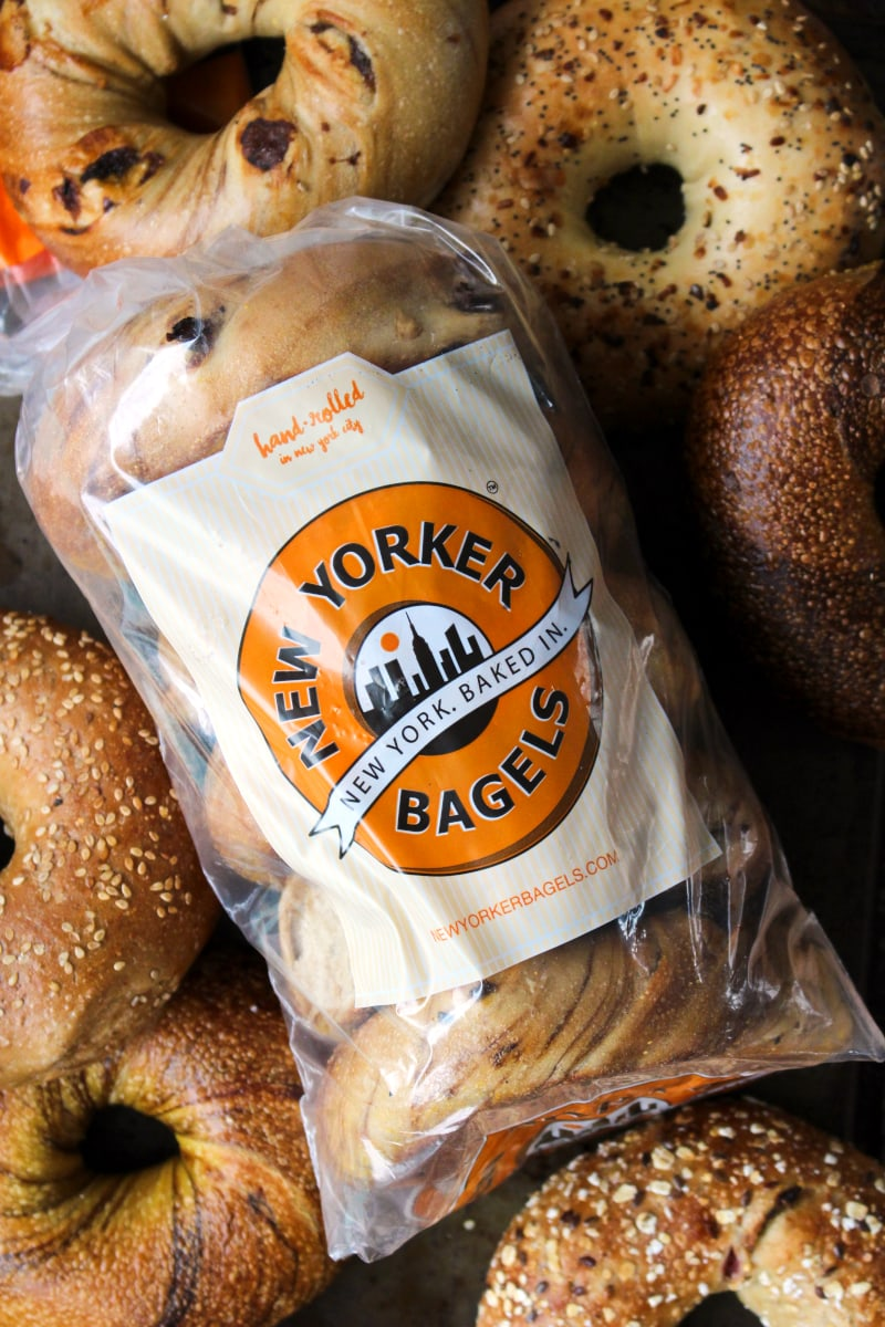 The Ultimate Bagel Bagel Brunch Board featuring New Yorker Bagels is loaded with bagel toppings galore!  A variety of spreads, fruits, vegetables, cheeses, meats, and a few unique toppings make this bagel board a showstopper. #breakfast #brunch #bagels #ad